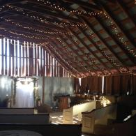Rustic antique pews provide comfortable seating for Barn Loft Weddings