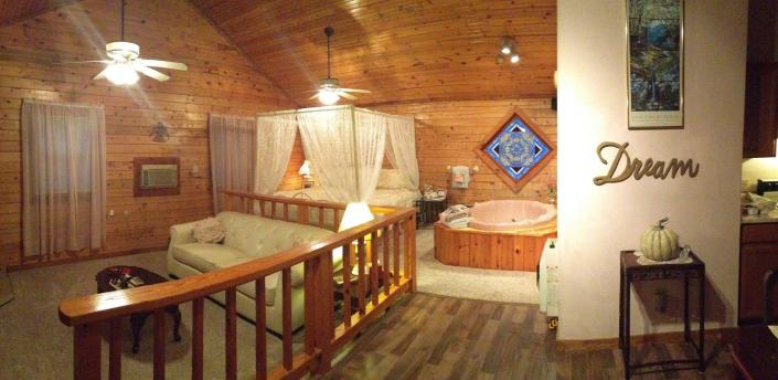 [Image: Cabin 4, Somewhere in Time:  King bed, Jacuzzi for two, Full Kitchen, Sunken living room, Covered front deck, Wilderness setting]