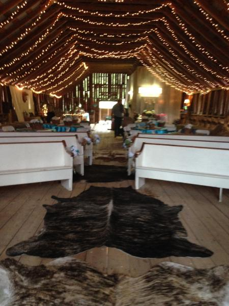 Sara and Eric brought cowhide rugs from home, setting off the bridal aisle perfectly!